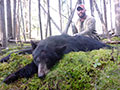 David Roberts of Oklahoma with his big mature Black Bear he harvested on the last day of his hunt, after passing on a ton of other Black Bears. :: Spring 2014