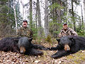John Miller and George Minges with their Manitoba B&C Trophy Black Bears that they harvested on the 1st evening of their hunt with us, Steeprock River Outfitters :: Spring 2014