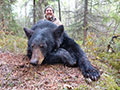 Ken Tronnier with his 14 yard archery kill Black Bear. :: Spring 2014