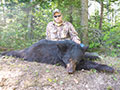 Nik Cramer of Pennsylvania with his Black Bear that he harvested out of the Porcupine Prov Forest. :: Spring 2014