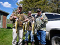 Rodney Johnson, Ken Tronnier, and Roy Mackey with some Walleye they caught prior to heading out to the bear stands.:: Spring 2014